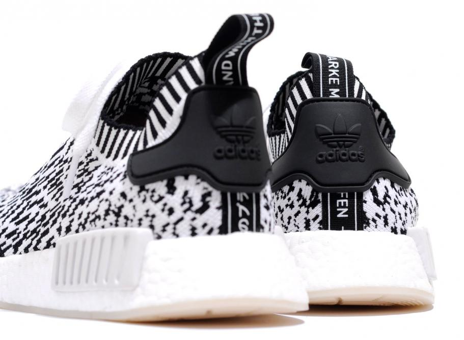110bad279 Adidas NMD R1 Primeknit Zebra White BZ0219   Soldes   Novoid Plus
